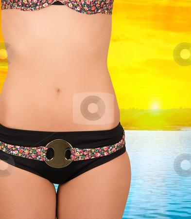 Beach stock photo, Girl at bikini closeup on beach background by olinchuk