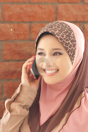 Young women speak on the mobile phone  stock photo, Beautiful young women speak on the mobile phone by zaihan