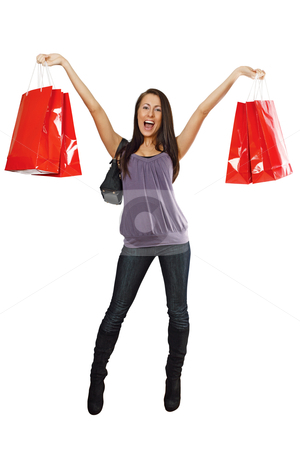 Shopping success stock photo, A very happy shopping girl holding bags and smiling wildly about her rabid consumerism.  by © Ron Sumners