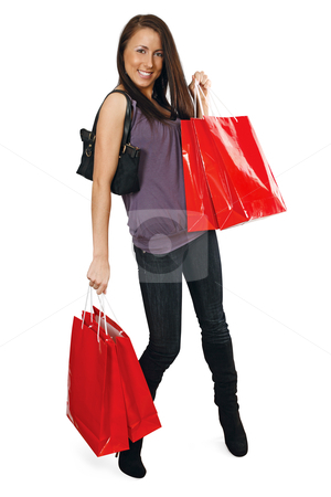 Shopping bliss stock photo, A very happy shopping girl holding bags and filled with glee.  by © Ron Sumners