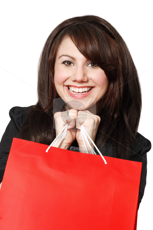 Shopping excitement stock photo, An crazy happy shopping girl holding bags and filled with glee.  by © Ron Sumners