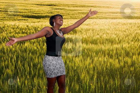 Black Woman in Winter Wheat Field stock photo, An allergy free african american black woman in a field of winter wheat by Robert Byron