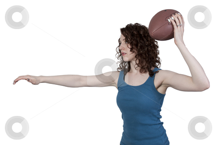 Woman Playing Football stock photo,  beautiful young woman quarterback while throwing a football by Robert Byron