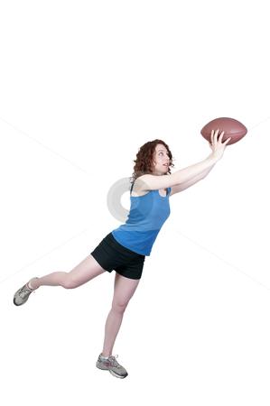 Woman Catching Football stock photo, A beautiful young woman catching a football by Robert Byron