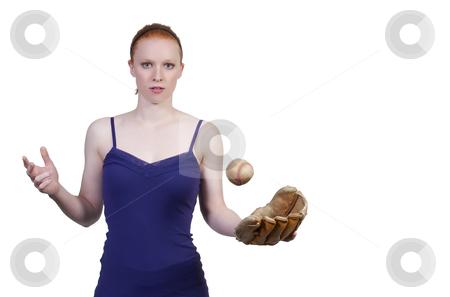 Woman Baseball Player stock photo, A beautiful woman throwing a baseball into the air by Robert Byron