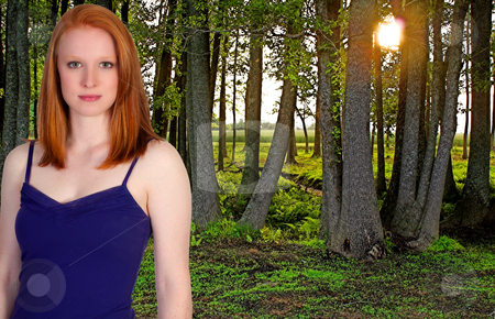 Beautiful Woman in a Spring Forest stock photo, A beautiful young woman standing in a green forest in the early spring of the year. by Robert Byron