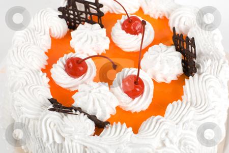 Cream cherry cake stock photo, cream cake closeup with cherry on a grey by olinchuk