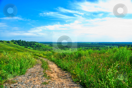 Summer landscape stock photo, Summer landscape with green grass, road and clouds by olinchuk