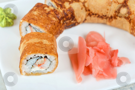 Pancake sushi stock photo, Sushi - made of crab meat, cheese, pancake outside by olinchuk