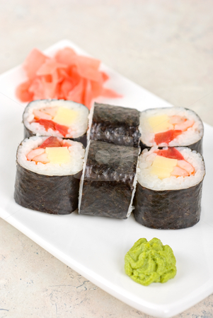 Sushi rolls stock photo, Sushi rolls made of crab meat, cheese, and tomato by olinchuk