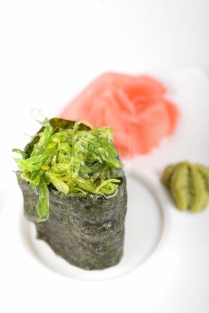 Maki sushi stock photo, Japanese fresh maki sushi with green seaweed by olinchuk