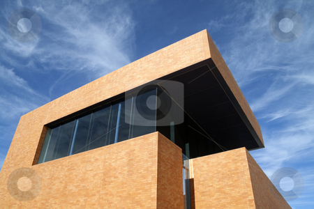 Modern Building stock photo, A modern brick building reaching into the blue sky  by Kevin Tietz