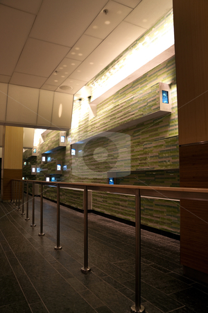 Empty Area stock photo, A empty waiting area with tiled wall and tvs by Kevin Tietz