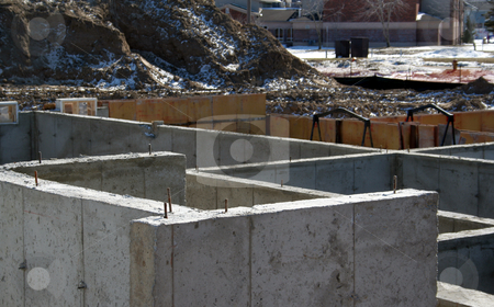 Strong Foundation stock photo, The cement foundation of a new housing development.  by Chris Hill