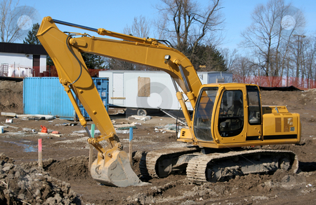 Backhoe stock photo, A large backhoe sitting on construction site. by Chris Hill