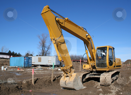 Big Scoop stock photo, A large backhoe sitting on construction site.  by Chris Hill