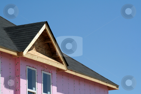 Townhouse Construction stock photo, The roof of a new townhouse under construction. by Chris Hill