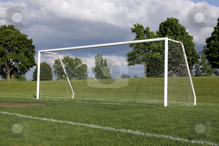 Lone Soccer Net stock photo, A view of a net on a vacant soccer pitch.  by Chris Hill