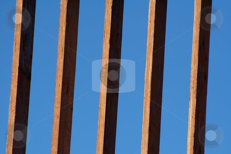 Beams stock photo, Beams of a new house frame set against the blue sky. by Chris Hill