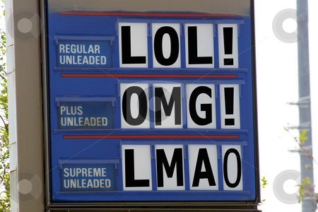 Funny Gasoline Price Sign stock photo, A gasoline price sign with commonly understood web acronyms instead of numbers. by Carl Stewart