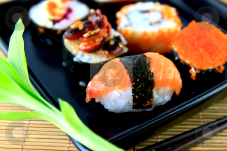 Traditional Japanese food Sushi. Closeup Japanese sushi on a dish stock photo, Traditional Japanese food Sushi. Closeup Japanese sushi on a dish by chaiwat