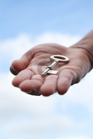 Hand giving a key  stock photo, Hand giving a key  by chaiwat