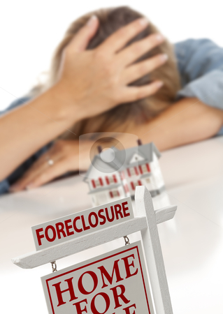 Woman, Head in Hand Behind Model Home and Foreclosure Sign stock photo, Woman with Head in Hand Behind Model Home and Foreclosure Real Estate Sign in Front. by Andy Dean