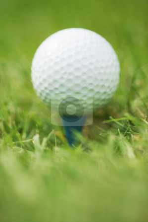 Detail of golfball on tee, concept photography stock photo, Golf ball on tee, concept photography by Bryan Mullennix