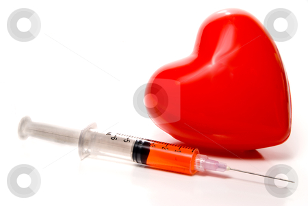 Medical Syringe stock photo, A Medical Syringe and a big red heart. by Robert Byron