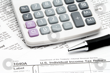 Tax Return stock photo, A calculator sitting on top of tax forms. by Robert Byron