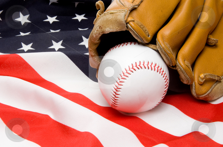 Baseball and Glove stock photo, A Baseball and Glove on an American Flag by Robert Byron