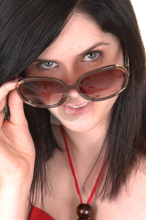 Closeup portrait of girl. stock photo, A closeup portrait of a young woman with sunglasses and black hair smiling into the camera, in a red dress.  by Horst Petzold