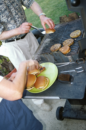 Couple barbecueing stock photo, Mature couple barbecuing, concept photography, model released by Bryan Mullennix