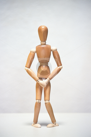 Wooden Mannequin Needs to Pee stock photo, Artists mannequin needing to use the bathroom, concept photography by Bryan Mullennix