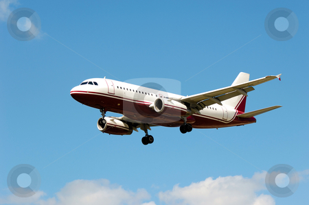 Plane stock photo, Plane flying in the air. by Lars Christensen