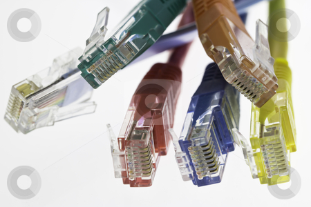 Detail of five network cables and a flat cable configuration stock photo, detail of five network cables and a flat cable configuration on a white background by ludinko