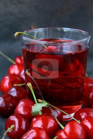 Glass of fresh cherry juice and fresh cherries stock photo, glass of fresh cherry juice and fresh cherries by Olga Kriger