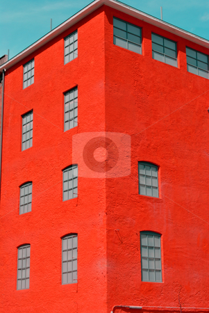 Former factory building stock photo, former factory building under renovation in postmodern style concrete faade red by freeteo