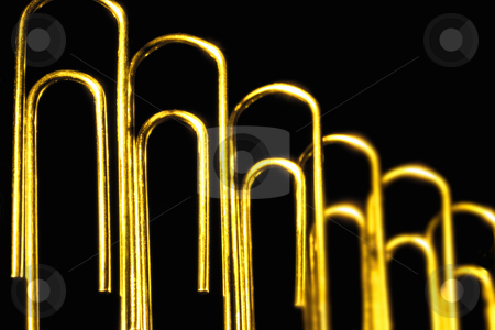 Paperclips stock photo, Paperclips on black background, concept photography by Bryan Mullennix
