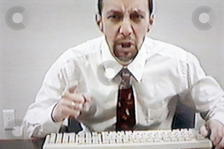 Angry businessman, concept photography stock photo, Video still of angry businessman teleconferencing, concept photography, model released by Bryan Mullennix