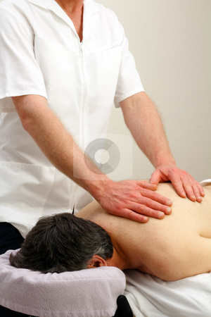 Back Relief stock photo, Male laying face down getting an upper torso massage from a professional male massage therapist.  by Lee Serenethos