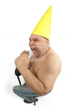 Dunce cap frustration stock photo, Fool sitting in the corner wearing a dunce cap freaking out.  by © Ron Sumners