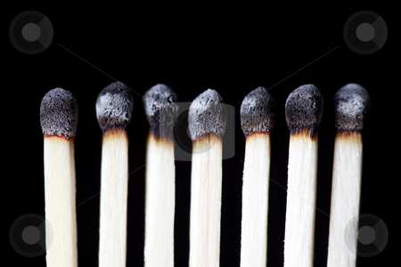 Burnt Matches, concept photography stock photo, Row of seven burned down wooden matches by Bryan Mullennix