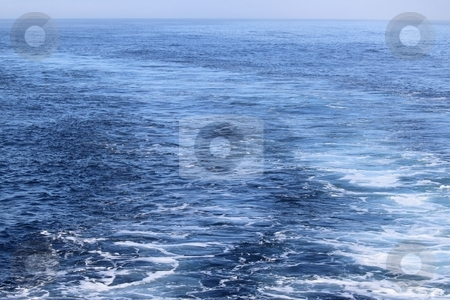 Ocean stock photo, view of blue ocean water with sun reflection on it by Henrik Lehnerer