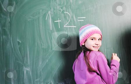 Happy young school girl portrait stock photo, happy young school girl portrait on math class by Benis Arapovic