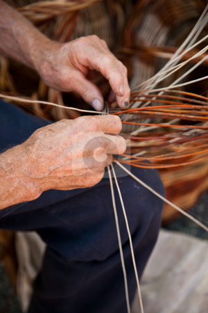 Handmade working stock photo, Old hands working in a basket costruction by Perseomedusa