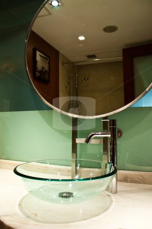 Hotel foniture - bathroom stock photo, Detail of hotel forniture - elegant sink made of glass by Perseomedusa