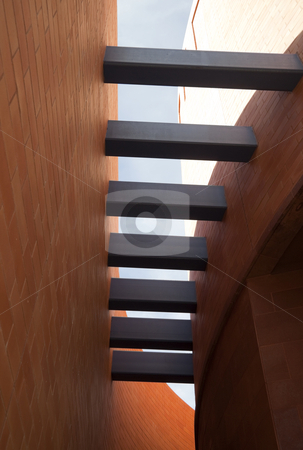 Curved Beams stock photo, A set of a building beams curved forming a trellis on the exterior by Kevin Tietz