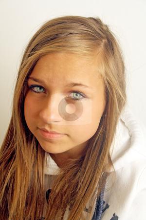 Depressed teenage girl stock photo, a pretty teenage girl looking depressed by lizapixels