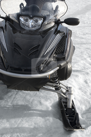 Snowmobile stock photo, photo of a black snowmobile on a snowy by catalby